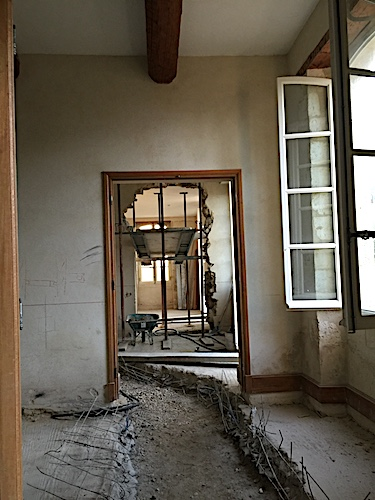 Before image of hallway in demolition