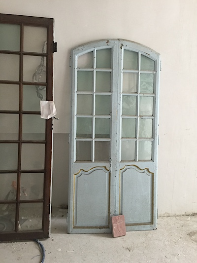 Before photo of old doors used in the Formal Powder Bath