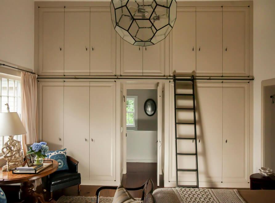 custom closet with ladder