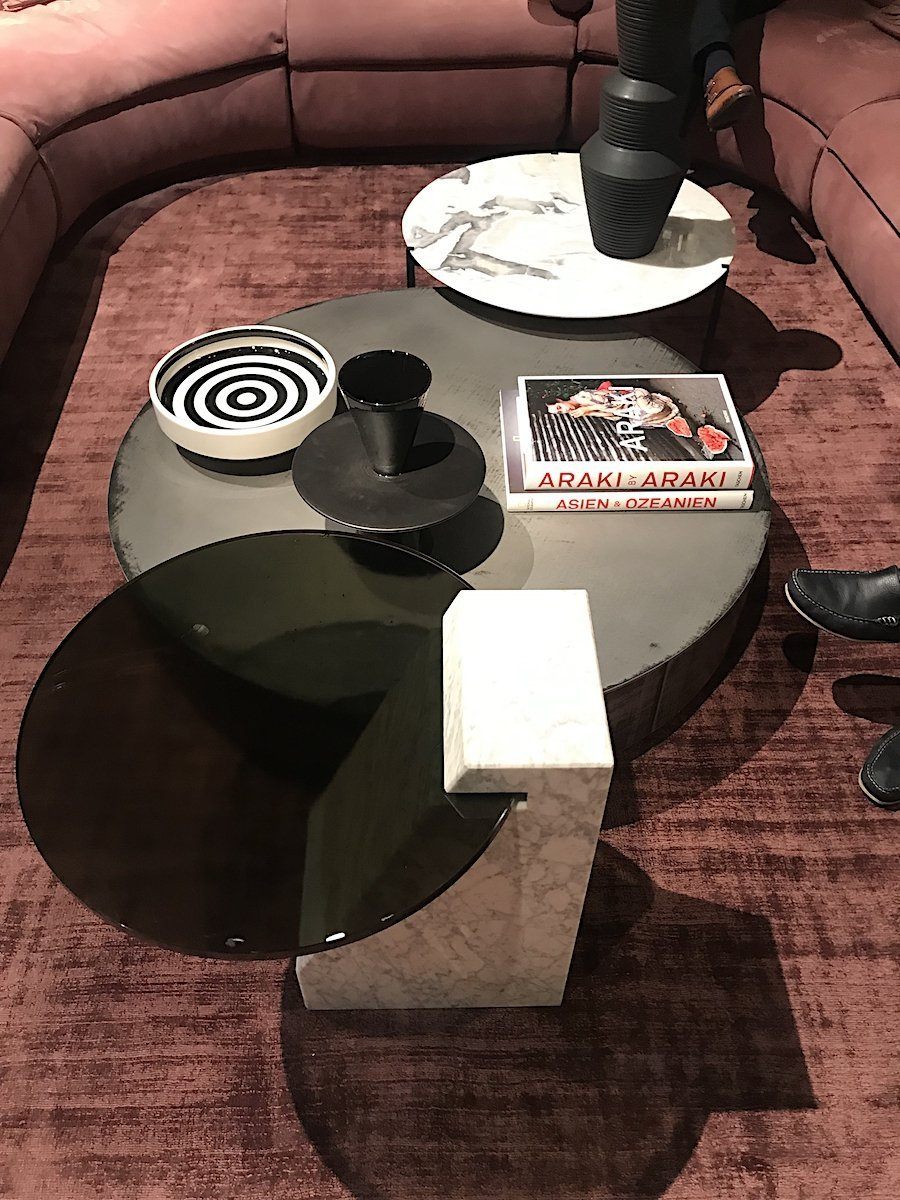 Baxter furniture modern round coffee tables in glass, marble and metal.
