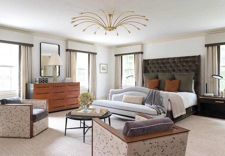 Warm modern master bedroom suite