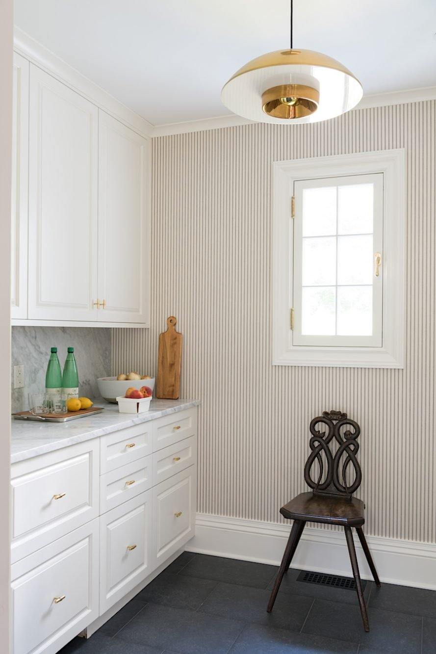 White Pantry remodel with bras accents